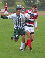 Huntington University's Marcos Salinas (left) and Grace College's Justin Festa collide as they battle for possession of the ball in the first half of a men's soccer game at King Stadium on Saturday, Oct. 3. The Foresters won, 2-1.