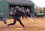 Natalie McGuire, a senior on the Huntington University softball team, smacks a double in the first of two games against visiting Spring Arbor University on Tuesday, April 4. The Foresters won the game, 2-0.