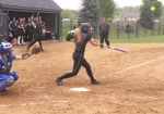 Amber Klopfenstein, a freshman on the Huntington University softball team, sends the ball flying in a game against visiting Bethel College on Friday, April 28. The Foresters swept the Pilots, 8-1, 11-1.