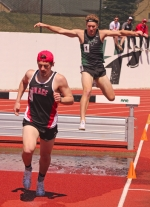 Austin Willey (right), a freshman on the Huntington University men's track team, prepares to plunge into the water pit while competing in the 3,000-meter steeplechase at the HU Invitational on Saturday, April 8. Willey won the race in 10:22.68.