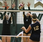 Huntington University volleyball players Hillary Pulse (left) and Heather Medich (middle) go up for a block during the Foresters' first game against visiting Mount Vernon Nazarene on Friday, Oct. 18.