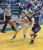 Huntington University guard Miranda Palmer drives the ball past a Goshen College defender on Tuesday night, Feb. 24, at Platt Arena. Palmer scored 19 of her game-high 24 points in the second half to lead HU to victory, 69-63.