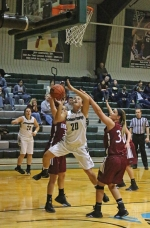 Huntington University forward Amelia Recker shakes her defender and goes up for a short shot in the opening round of the Huntington University Classic on Friday night, Nov. 20. Recker tallied 13 points in the second half as HU won, 72-64.