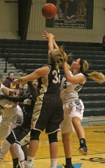 Allyson Trout (right), a junior on the Huntington University women's basketball team, has her shot contested by Nichole Davidson, of visiting University of St. Francis (IL), during a game on Saturday, Nov. 21, the second day of the HU Classic. The Foresters lost, 65-50.