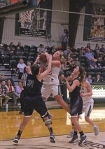 Brooke Saylor (middle), a sophomore on the Huntington University women's basketball team, encounters resistance from Mount Vernon Nazarene's Natalie Thomas while attempting to score in the paint during a game at Platt Arena on Saturday, Jan. 21. The Foresters won, 87-73.