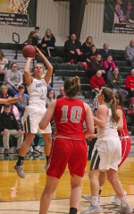 Huntington University forward Paige Coolman launches a short jumper against Indiana Wesleyan University at Platt Arena on Saturday, Feb. 4. Coolman scored four points off the bench in the Foresters' 56-55 win.