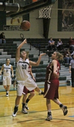Huntington University's Amelia Recker (left) tries slipping past two Indiana University Southeast defenders for a layup in the first half of the HU Tournament championship game on Saturday, Nov. 22.
