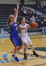 Huntington University guard Kelsey Hubble kicks out a pass to a teammate during action Wednesday night, Jan. 27, against the University of Saint Francis at Platt Arena. The Foresters lost, 50-39.