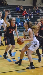 Huntington University senior guard Kelsey Hubble (right) is about to challenge Grace's Sarah Feasby on a lay-up attempt in action Wednesday night at Platt Arena. Hubble scored on the play but HU lost the game, 61-55.