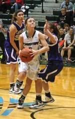 Huntington University's Miranda Palmer fixes her eyes on the hoop as she takes off for a layup in the second half of the Foresters' game against visiting Taylor on Saturday, Feb. 21. Palmer scored 21 to lead HU to a 65-53 win.
