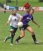 Huntington University forward Millie Adams battles with Courtney Wengard of Goshen College in women's soccer action Saturday, Sept. 24, at HU.