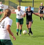 Huntington University forward Sarah Church (left) and Grace College defender Kristen Bellinger battle for the ball in the first half of a women's soccer game at King Stadium on Tuesday, Oct. 11. The game went into double overtime and ended in a 1-1 tie.