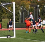 Olivia Knispel (leaping), a junior midfielder on the Huntington University women's soccer team, jumps up to head the ball on a Forester corner kick, but Marian University goalie Madeline Weber (middle) is there to make the save during the first half of a game at King Stadium on Saturday, Oct. 10. The Foresters lost, 4-2.