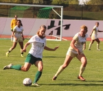 Brandi Spear (left), a senior on the Huntington University women's soccer team, passes the ball during a game against the University of St. Francis at King Stadium on Friday, Sept. 15. The Foresters won, 3-2.