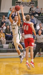 Huntington University forward Tyler Arens tries an off-balance shot over Jack Halverson of St. Xavier on Saturday, Nov. 3, in action at Platt Arena. The Foresters lost, 83-80.