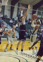 Huntington University guard Zac Owens challenges Tanner Camp of Goshen College on a drive in action Tuesday night, Feb. 5, at Platt Arena. Owens scored 18 as the Foresters won, 75-51.