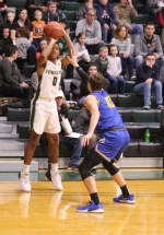 Huntington University guard Peyton West lines up a jumper over a Madonna defender on Saturday, Nov. 23, at Platt Arena. West tallied 20 but HU lost, 86-85.