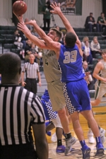 Huntington University's Caleb Middlesworth (left) extends his arm to the hoop while Saint Francis' David Miller attempts to stop him during a men's basketball game on Tuesday, Jan. 22, at Platt Arena. The Foresters beat the Cougars, 77-74.