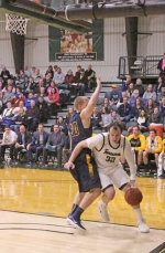 Huntington University center Trevor Lockwood maneuvers down low against Jeff Beckman of Spring Arbor University in action Saturday afternoon at Platt Arena. The Foresters lost, 89-81.