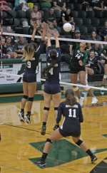 Huntington University outside hitter Brandy Michie goes up for a spike against Life Pacific on Saturday morning, Aug. 18, on day two of the Forester Invitational at HU.