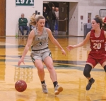 Huntington University player Erin Mohr comes to a stop with the ball as she looks to find room to maneuver in action Saturday, Nov. 16, against  IU Southeast. The Foresters won the championship of the Huntington University Classic 76-65.