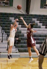 Huntington University's Sarah Fryman unleashes a shot over an IU Southeast defender in the championship game of the Huntington University Tournament on Saturday, Nov. 18. The Foresters won, 61-41.