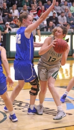 Huntington University's Sarah Fryman works in the paint against a Bethel defender on Saturday, Jan. 11. Fryman scored a game-high 27 points to lead HU to a 71-63 win.