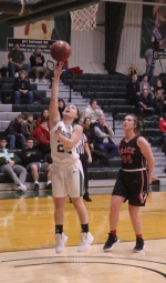Sara Doi goes to the hoop in action against visiting Grace on Saturday, Dec. 8. The Foresters won big, 77-53.
