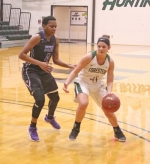 Maddie Richer (right), a member of the Huntington University women's basketball team, dribbles around a defender from visiting Cincinnati Christian University during a game on Friday, Dec. 29. The Foresters got edged, 60-58.