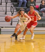 Huntington University guard Maddie Richer drives past and Indiana Wesleyan University defender in Saturday's action at Platt Arena. The Foresters upset the No. 16 Wildcats, 67-59.