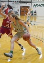 Huntington University forward Sarah Fryman goes hard to the basket against a defender from IU Northwest on Monday, Dec. 30, at Platt Arena. Fryman scored a game-high 22 points to lead HU to the win.