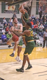 Nick Macon (left), a senior on the Huntington University men's basketball team, dishes the ball to a teammate during the Foresters' game against Wright State Lake on Tuesday, Oct. 30, at Platt Arena. The Foresters beat the Lakers, 112-103.