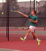 Huntington University tennis player Rodrigo Manzo returns a forehand during the second doubles match against visiting Indiana Wesleyan University on Tuesday, Sept. 19. The Foresters lost, 2-7.