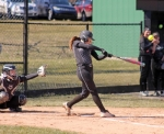 Huntington University hitter Paige Eichelberger drives the ball against host Manchester University on Saturday, March 10. The Foresters dropped both ends of a doubleheader by a run.