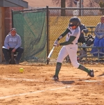 Paige Eichelberger, a sophomore on the Huntington University softball team, makes contact with the ball during the first of two games against visiting Mount Vernon Nazarene University on Tuesday, March 26. The Foresters' first two home games of the season got spoiled by the Cougars, who won 3-1 and 22-8.
