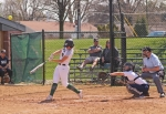 Jada Crofoot (left), a sophomore on the Huntington University softball team, smacks the ball during the first of two games against visiting Spring Arbor University on Tuesday, April 16. The Foresters won the game, 8-7, and the one that followed, 4-0.