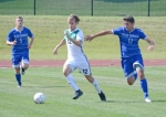 Huntington University midfielder Eric Ocock races downfield with the ball as Lawrence Tech's Mario Colella tries to slow him down in action Saturday afternoon at King Stadium. The Foresters won in overtime, 2-1.