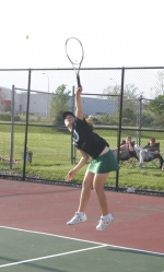 Huntington University doubles player Haley Neiderheiser hits a serve during the Foresters' match against visiting Taylor of Friday, April 30.