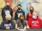 Huntington North High School senior Hanna Whitney (bottom row, center) signs to continue her academic and running careers at Hanover College. The signing ceremony took place on Tuesday, Feb. 23. Also featured are (bottom row, left) her mother, Tina Whitney, and father (bottom row, right) Randall Whitney, along with Huntington North coaches (top row, from left) Brian Milton, Matt Ditzler and Carrie Boxell.