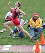 Huntington North High School long jumper Alyssa Hurlburt takes off under the watchful eyes of officials during regional competition on Tuesday, May 26. Hurlburt advanced on to next week's state meet.