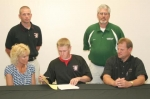 Huntington North High School baseball player Jamon Hammel (front center) looks over his letter of intent to play college ball at Huntington University.