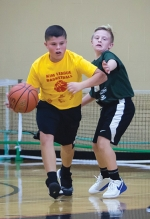 Gage Clanin (left) and Rhett Holzinger compete in a recent KIM League basketball game at the Parkview Huntington Family YMCA. Registration opens for the league's co-ed middle school division on Monday, Jan. 6