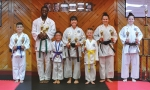 Members of Genbu-Kai Karate of Indiana show off their trophies won at the Summer Smash Karate Tournament in Fort Wayne on July 22. Pictured (from left) are Jaiden Kirk, Kevin McGregor, Lextin Keefer, Sensei Dawn Anderson, Mason Payton, Amanda Anderson and Melanie Anderson. Not pictured are Aiden Miller, Rachel McGregor and Gretchen Schaadt.