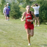 Robyn Karst leads the HNHS girls' cross country reserve team to a first place finish.