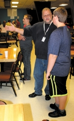 Ed Tackett (middle), the new head of Huntington North High School's bowling program and head coach of the boys' varsity team, gives some pointers to AJ Martin (right) during practice at Oak Lanes Bowling Center, in Huntington, on Thursday, Nov. 14.