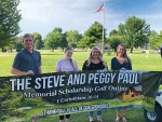 Recipients of the Steve and Peggy Paul Memorial Scholarship hold a banner thanking sponsors of the annual golf outing fund-raiser. Pictured (from left) are Wade Kingrey, Miranda Smart, Haley Burnau and Madeliene Laymon. Not pictured are Josi Barscz, Karmen Koch and Savannah Scott.