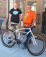 Chris Bucher (left) from Trailhouse Village Bicycles in Winona Lake and Jim Lewis, HARTA president, display the bicycle presented to the winner of the 2017 Adult division winner. The group will host the fourth annual Heritage Days Bicycle Poker Ride on Sunday, June 24, at 2 p.m.