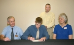 Huntington North High School senior Will Schenkel (front, center) signs a letter of intent to play basketball at Purdue University-Calumet next year.