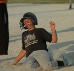 Scott Foust of McElhaney-Hart Funeral Home slides into third base during the team's victory over F.O.P. 77 on Thursday, July 9, in the PAL Little League Tournament.