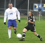 Huntington North High School freshman midfielder Mitchel Schneider manuevers around a Homestead defender during sectional soccer action on Thursday, Oct. 8. The Vikings lost 7-2.